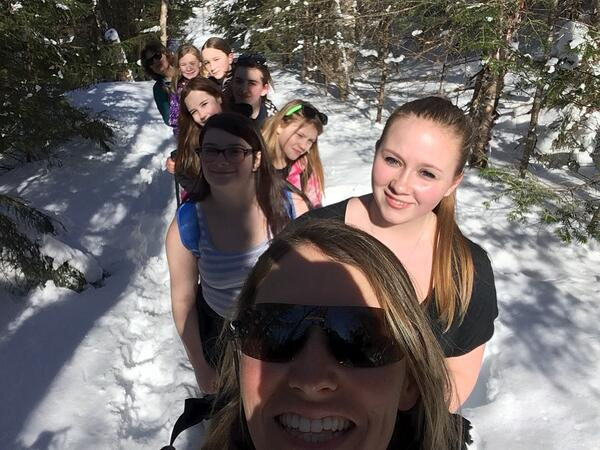 Profile students snowshoeing